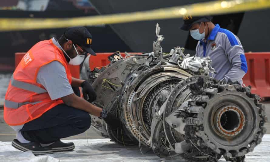 Investigators check debris of the Lion Air plane that crashed off Jakarta on 29 October.
