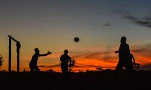 Farc members play football at the camp in Llanos del Yari