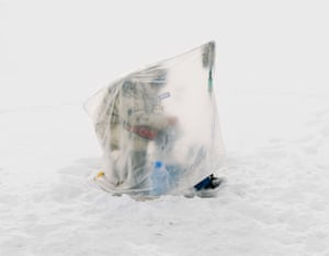 The only shelter separating the fishermen from the extreme conditions is a single sheet of plastic, the photographer discovered.