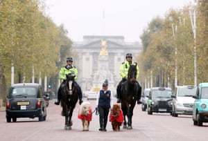 London, UK: Metropolitan police officers PC Clare Rees (left) and Insp Simon Rooke ride Merlin and Quixote alongside Shetland ponies Teddy (left) and Doris, who are accompanied by their handler Rachel Francis, during a photocall for the forthcoming Olympia Horse Show