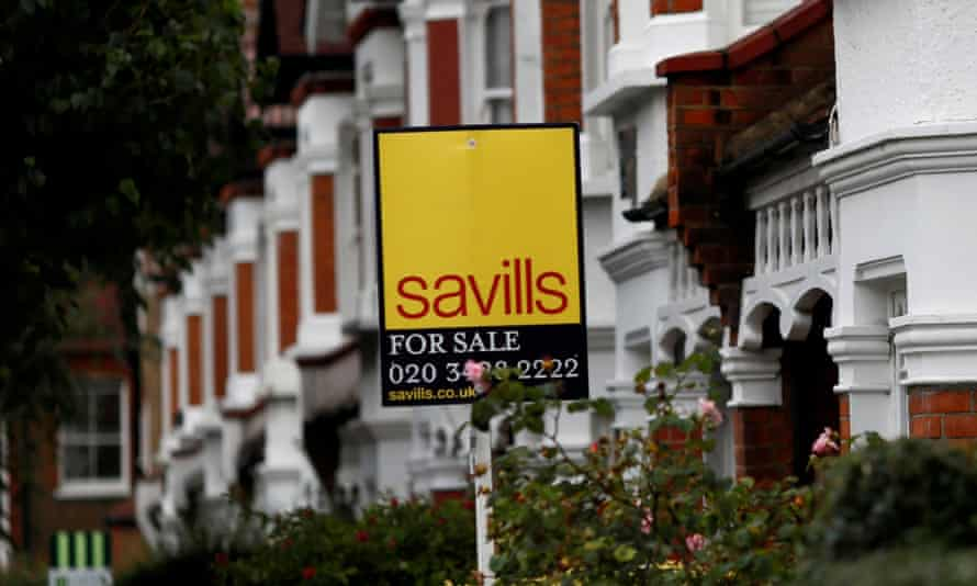 A Savills estate agent sign outside a home in south London