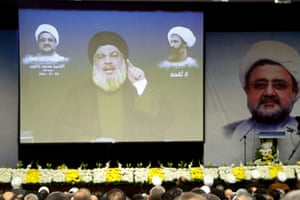 Lebanon's Hezbollah leader Hassan Nasrallah addresses his supporters via a screen in Beirut's southern suburbs.