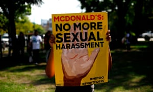 A McDonald's employee holds a sign during a protest against sexual harassment in the workplace, in Chicago on 18 September 2018.