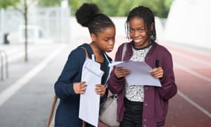 Twins Onyinyechi (left) and Amarachi Orie receive their GCSE results at Evelyn Grace academy in Brixton, south London.