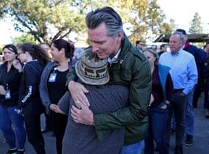 Governor Gavin Newsom hugs an evacuee at the Petaluma Fairgrounds in Petaluma, California on 27 October 2019.