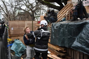 A bailiff tries to evict an activist from the HS2 protest camp at Euston Square Gardens