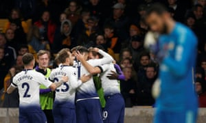 Tottenham players celebrate with Harry Kane after his goal put the visitors 3-0 up.