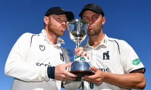 The Warwickshire and England veterans Ian Bell and Jonathan Trott pose with the Division Two trophy after the rout of routed second place Kent.