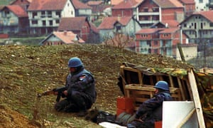 Serbian policemen take their position near the village Doneje Prekaze in the Serbian province of Kosovo , March 1989.