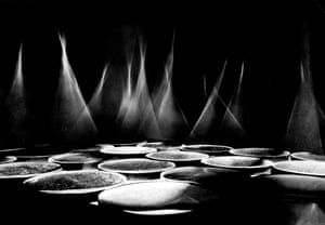 """Focussierender Raum (Focussing Space), 1968An exhibition at the Rijksuniversitaet in Utrecht, using cigarette smoke. The smoke amplified the cones of light, dissociating them from the concave mirrors beneath. """"It creates an energetic sculpture,"""" said Luther. """"It is an ethereal figure of alterability and transience."""" These days, the cigarette smoke is simulated by a fog machine."""