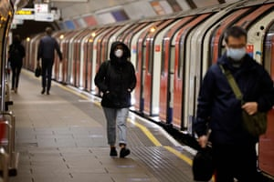 Commuters travel on the London underground