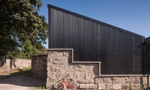 The old garage's new black 'corrugated iron' profile roof is from cladco.co.uk.