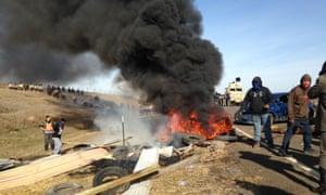 Dakota Access oil pipeline protesters burn debris as officers close in