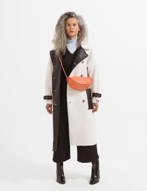 model wears coat, £99, topshop.com. Roll neck, £89, marksandspencer.com. Jumpsuit, £125, peopletree.co.uk. Boots, £290, aeyde.com. Bag, £88, arket.com