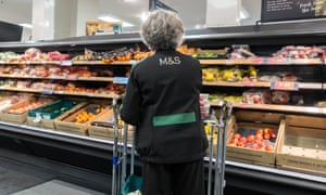 A female employee in a food hall of a Marks and Spencer store.
