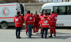 Volunteers from the Syrian Arab Red Crescent stand near ambulances on Monday.