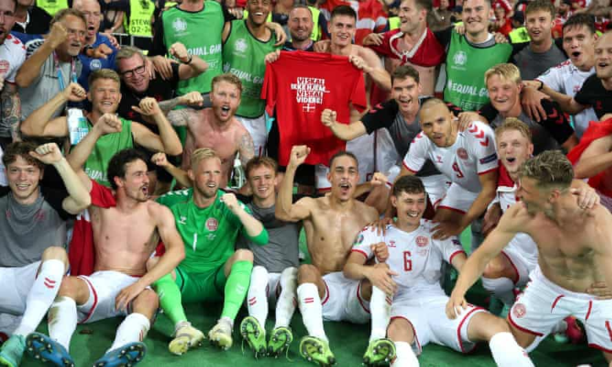 Denmark's players celebrate after the match