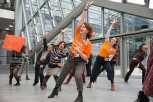 """Representatives of the Women and Gender constituency conduct an aerobics class to remind COP23 delegates to metaphorically """"mind the gap"""" of gender inequality, and """"reach"""" for a gender action plan."""