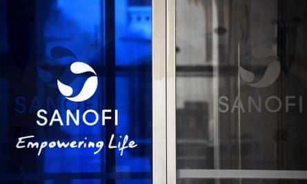 Photograph of the Sanofi corporate logo on blue glass at the company's HQ.