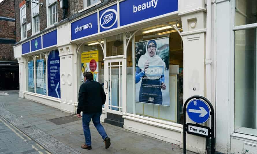 A man walks past a Boots pharmacy in York