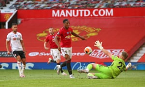 Anthony Martial lifts the ball over Blades' keeper Simon Moore for his, and Manchester United's, third.