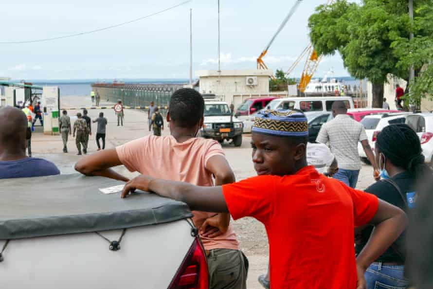 People await the arrival of more ships from Palma as people flee attacks by rebel groups.