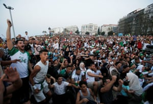 Fans celebrate the goal in Algiers.