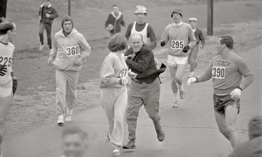 Jock Semple tries to throw Kathrine Switzer out of the 1967 Boston marathon. Tom Miller, right, is about to intervene.