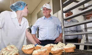 Scott Morrison chats to a worker in a bakery in Queensland.