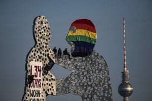 Berlin, Germany Activists occupy the Molecule Man sculpture to draw attention to Liebig 34, a squat and collective in the district of Friedrichshain, which is threatened by eviction