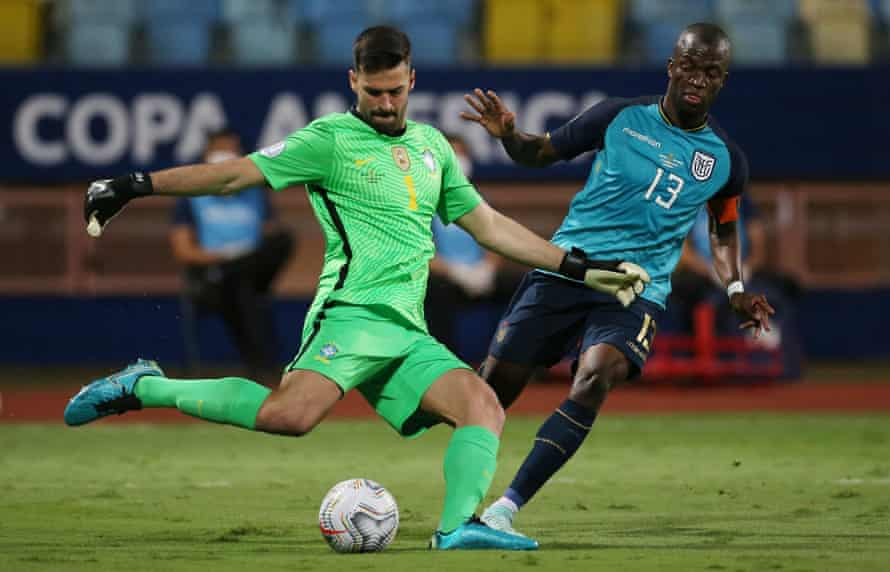 Alisson clears for Brazil during their Copa América game against Ecuador.