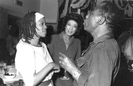 Busby (left) with the journalist Moira Stuart and the writer James Baldwin