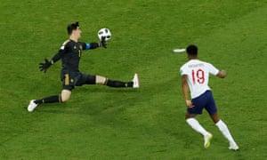 Belgium's Thibaut Courtois thwarts England's Marcus Rashford.