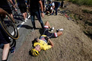 Race leader and yellow jersey holder Trek Factory rider Fabian Cancellara lies on the ground after falling