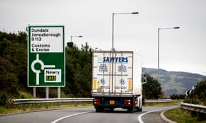 A lorry passes close to the border between Northern Ireland and Republic of Ireland just outside Newry.