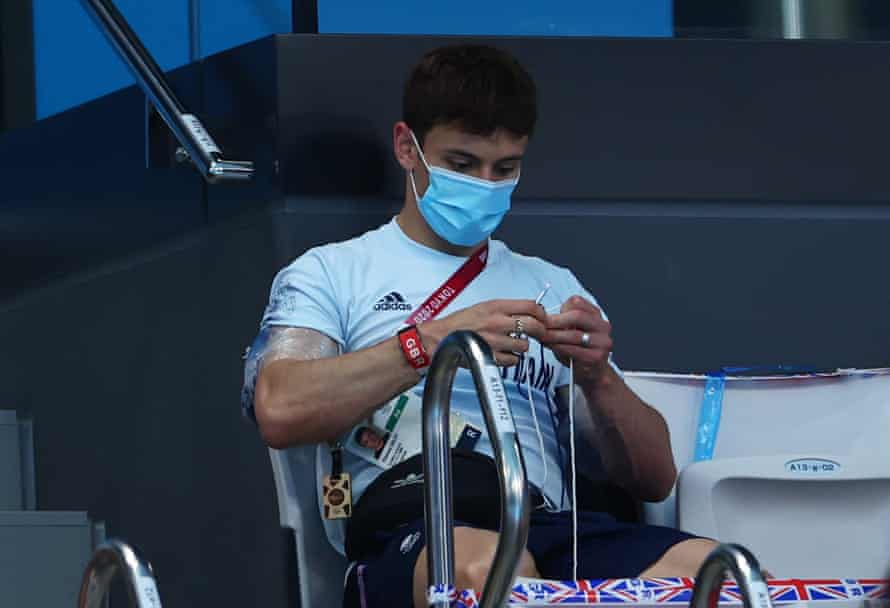 Tom Daley knitting in the stands at Tokyo 2020