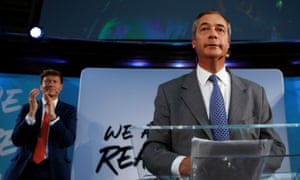 The Brexit party chairman, Richard Tice, applauds Nigel Farage at a press conference in August 2019