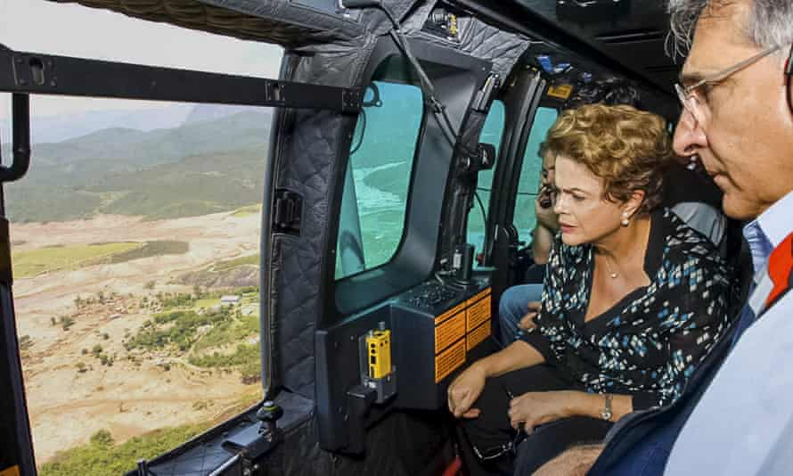 President Dilma Rousseff views the damage caused by the collapse of two dams that released toxic mud in Brazil's state of Minas Gerais.