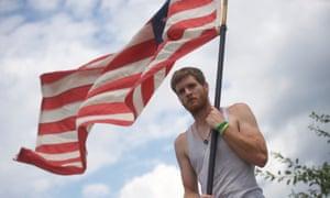 man waving flag