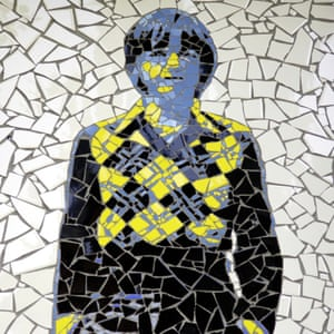 A mural showing Mark E Smith in an Argyle jumper.