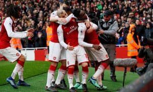 Arsenal's Danny Welbeck celebrates scoring their third goal with teammates.