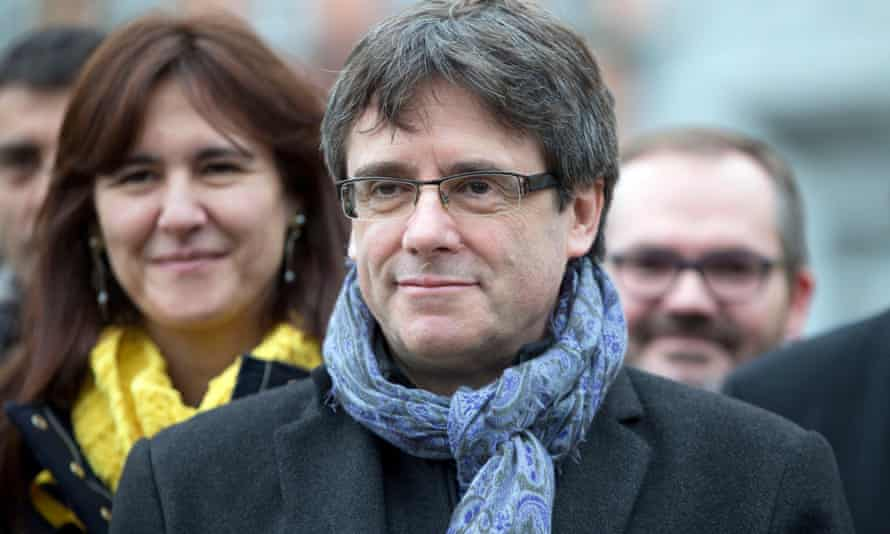 Carles Puigdemont with Catalan politicians from his Together for Catalonia party in Brussels in January.