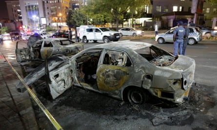 The burned out remains of two cars in Sandton, Johannesburg