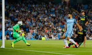 Manchester City's Sergio Aguero nips in to open the scoring.