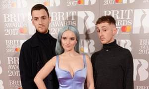 Clean Bandit, otherwise known as Grace Chatto and two AI robots concealing nuclear weapons within their necks.