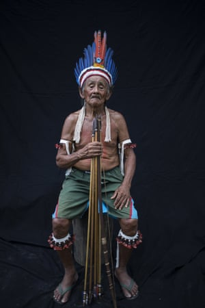 """chieftain Lorival Tembe poses for a portrait during a meeting of the Tembe tribes in the Tekohaw village, in the Alto Rio Guama Indigenous Reserve, in Brazil's Para state. """"The Amazon is ending and that's why we're here — so that it doesn't end,"""" said Lorival, the eldest chieftain and a founder of Tekohaw village"""