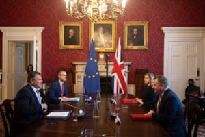Maros Sefcovic (left) and Lord Frost (right) at the meeting of the partnership council and the withdrawal agreement joint committee at Admiralty House this morning. Frost is sitting alongside Penny Mordaunt, the Cabinet Office minister.