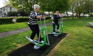 Women use an outdoor gym.