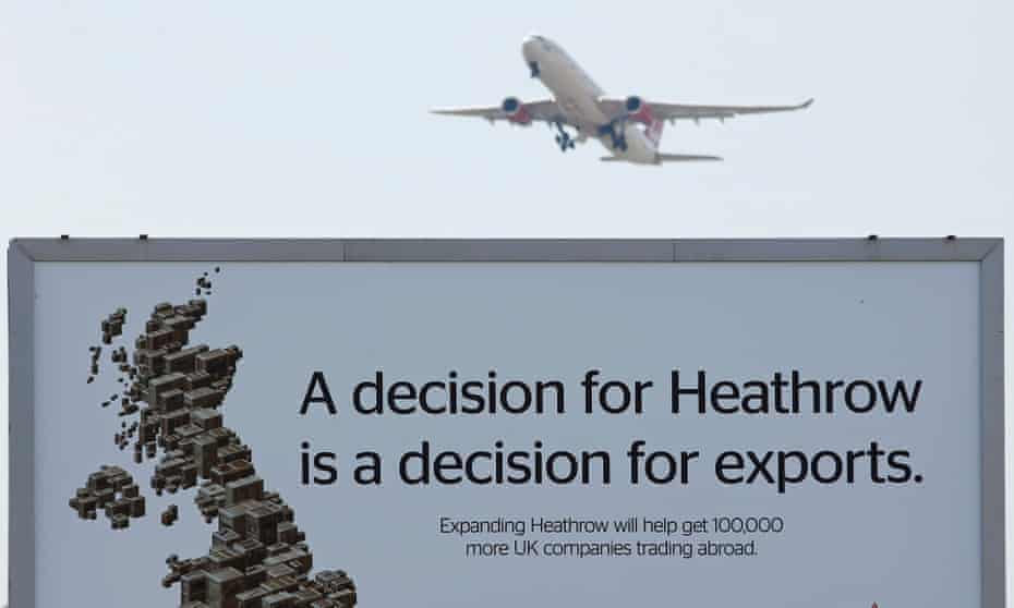 An aircraft takes off from Heathrow airport over a pro campaign poster on 1 July 2015. 'If there is a difficult question that has been ducked for too long, then that is the one about decarbonising the economy.' Photograph: Peter Nicholls/Reuters