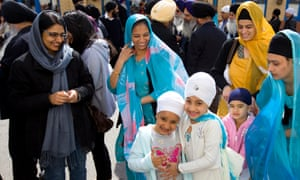 A Sikh family attending Derby's temple.